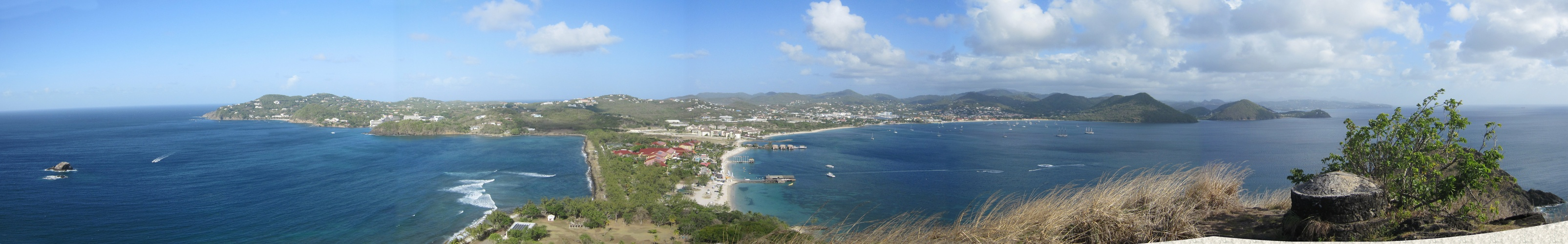 Panoramic view from Signal Peak on Pigeon Island - Cap Estate to the left, the red roofs of Sandals in the middle on the causeway,